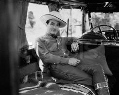 Tom Mix Rides Away into the Night in Honduras.